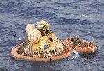 Astronauterne Neil Armstrong, Edwin 'Buzz' Aldrin og Michael Collins vender tilbage til jorden efter en udflugt til månen